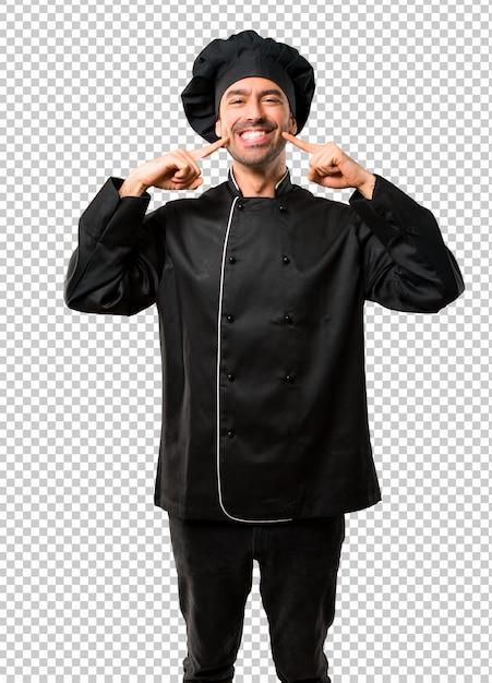 Homem de chef de uniforme preto, sorrindo com uma expressão feliz e agradável Psd Premium
