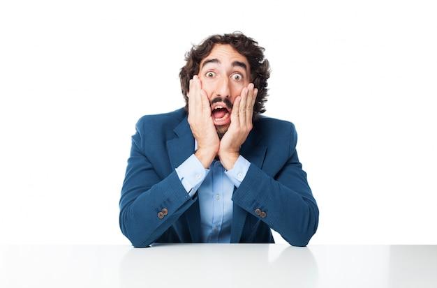 Homem de negócios espantado com mãos na face Psd grátis