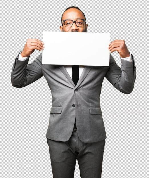 Homem de negócios preto segurando um cartaz Psd Premium
