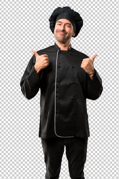 Homem do cozinheiro chefe no uniforme preto dando os polegares acima do gesto com ambas as mãos e sorriso. Psd Premium