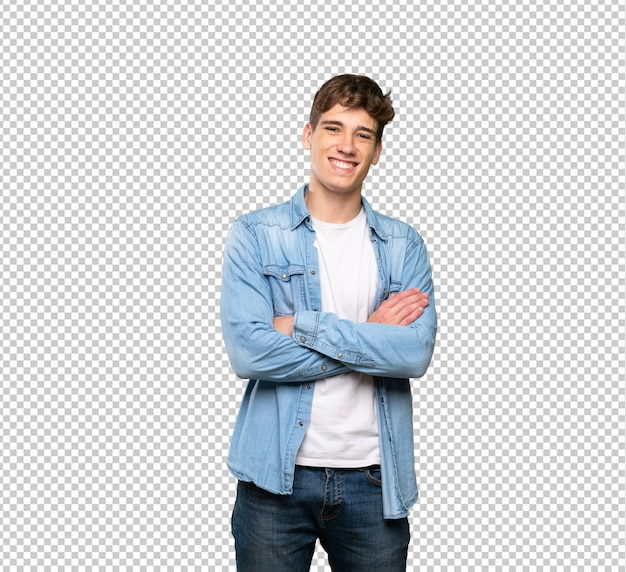 Homem jovem bonito, mantendo os braços cruzados em posição frontal Psd Premium