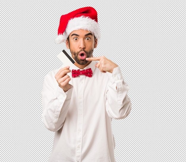 Homem jovem, desgastar, um, papai noel, chapéu, ligado, dia natal Psd Premium