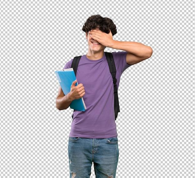 Homem jovem estudante cobrindo os olhos pelas mãos Psd Premium