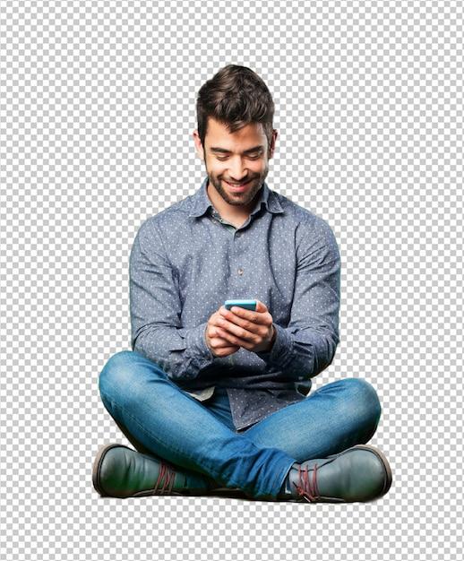Homem sentado no chão espantado com o celular Psd Premium