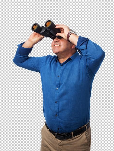Homem usando binóculos Psd Premium