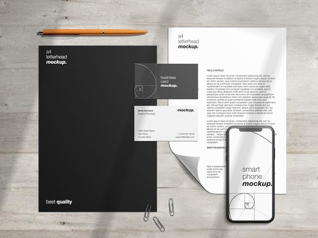 Identidade corporativa profissional modelo de maquete de papelaria e criador de cena com papel timbrado, cartões de visita e smartphone Psd Premium
