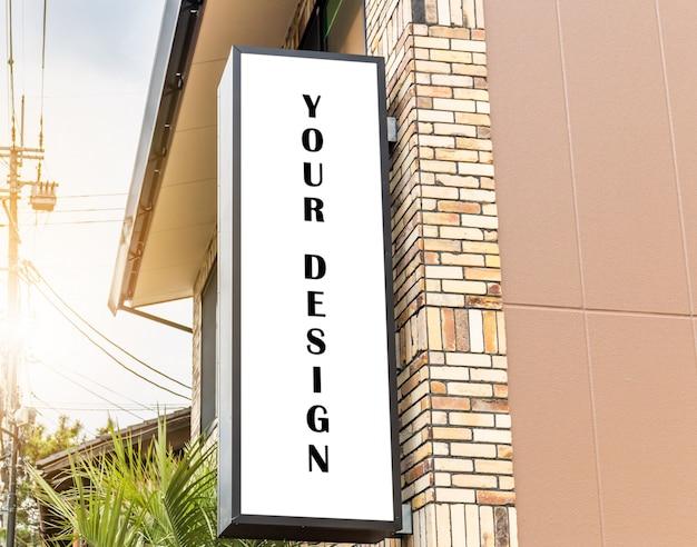 Imagem da maquete de cartazes de tela branca em branco outdoor e levou a frente da loja para publicidade Psd Premium