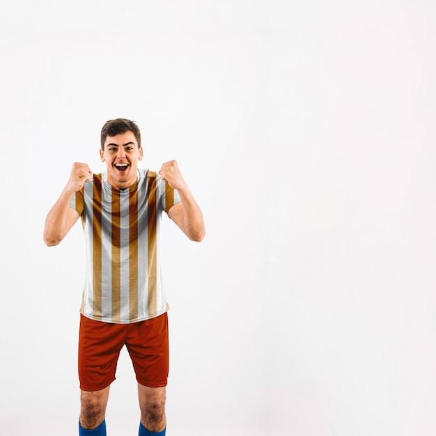 Jogador de futebol comemorando Psd grátis