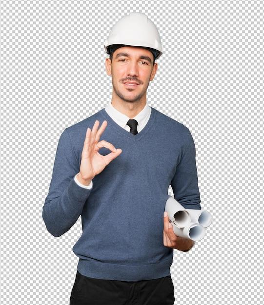 Jovem arquiteto fazendo um gesto de ok com a mão Psd Premium