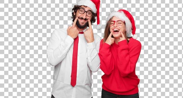 Jovem casal expressando o conceito de natal. casal e plano de fundo em diferentes camadas Psd Premium