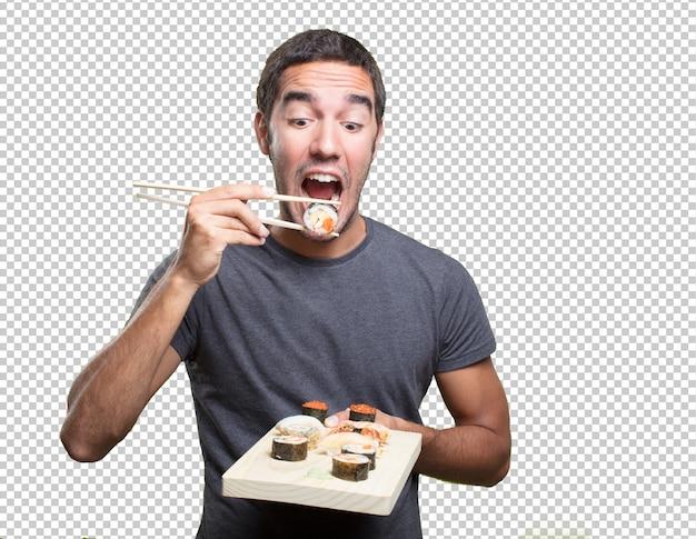 Jovem, comer, sushi Psd Premium