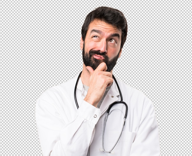 Jovem médico pensando | PSD Premium