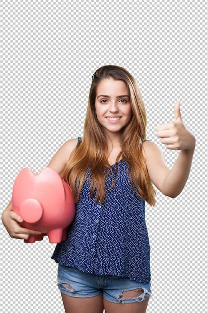 Jovem mulher bonita fazendo o gesto bem segurando um cofrinho Psd Premium
