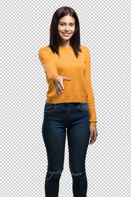 Jovens bonitas mulher estendendo a mão para cumprimentar alguém ou gesticulando para ajudar, feliz e animado Psd Premium