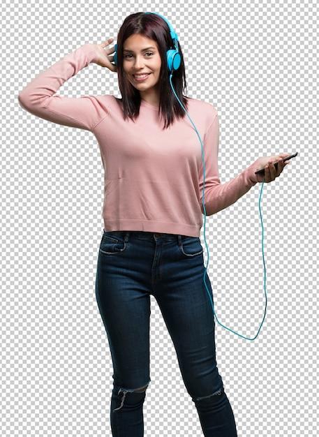 Jovens bonitas mulher feliz e divertida, ouvindo música, fones de ouvido modernos, felizes sentindo o som e o ritmo Psd Premium