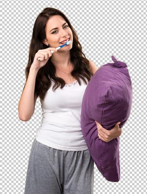 Linda garota com um travesseiro e com uma escova de dentes Psd Premium