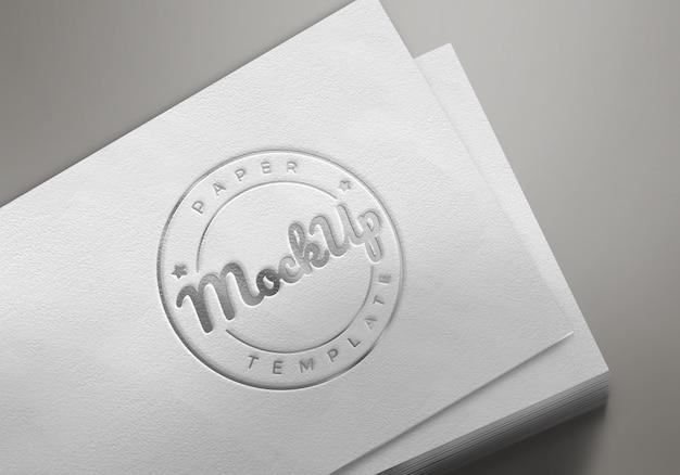 Livro branco com maquete do logotipo em relevo Psd Premium