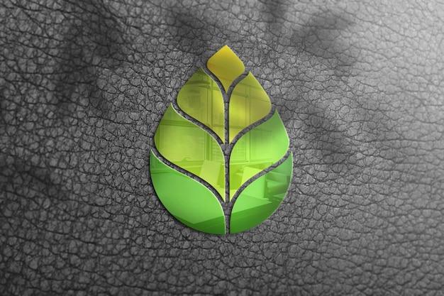 Logotipo de maquete de vidro em uma parede preta com textura de couro Psd Premium