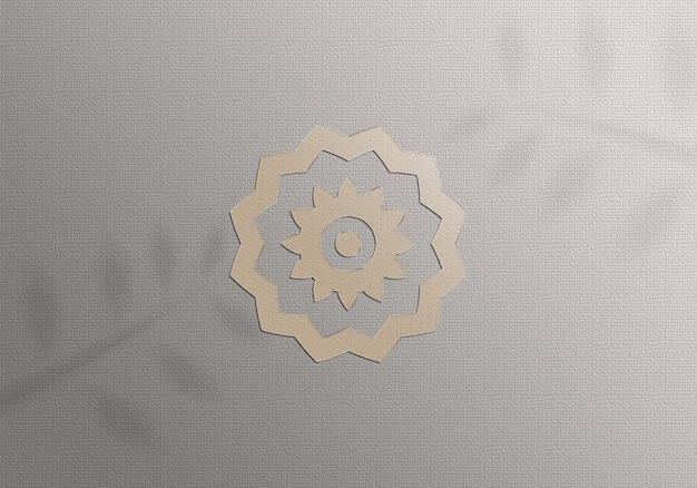 Logotipo dourado de maquete realista no papel Psd Premium