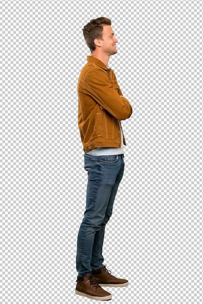 Loiro homem bonito em posição lateral Psd Premium