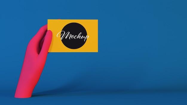 Mão-de-rosa segurando uma maquete de cartão de visita Psd Premium