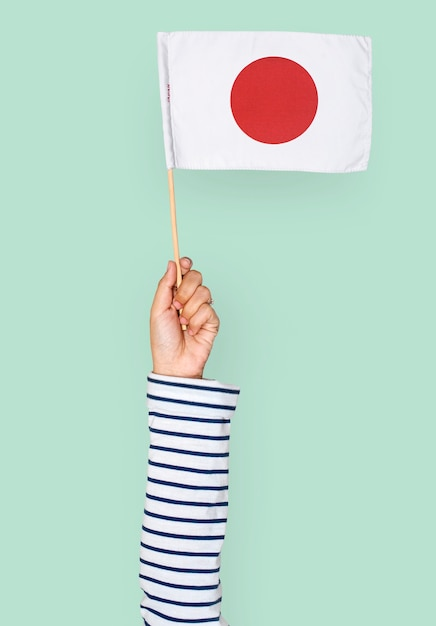 Mão, segurando, bandeira japonesa Psd grátis