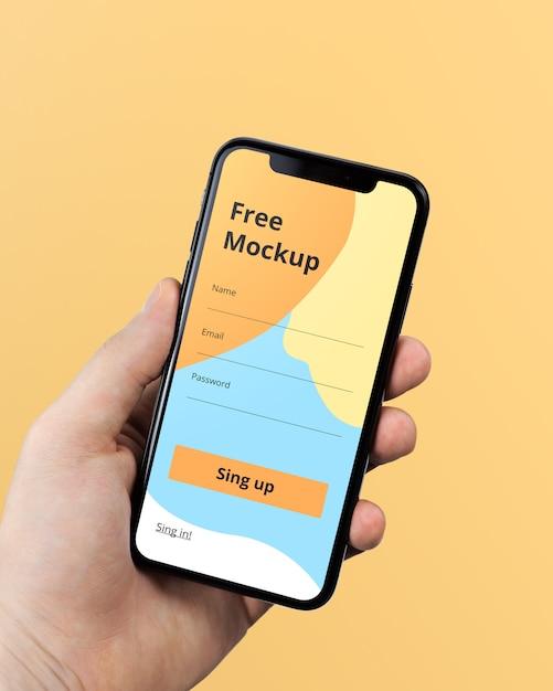 Mão segurando o iphone x mockup Psd Premium
