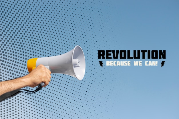 Mão segurando o megafone em um protesto Psd grátis