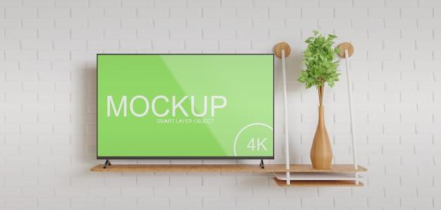 Maquete da tv na vista frontal da mesa de madeira Psd Premium