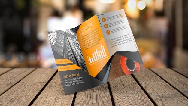 Maquete de brochura com três dobras na mesa Psd grátis
