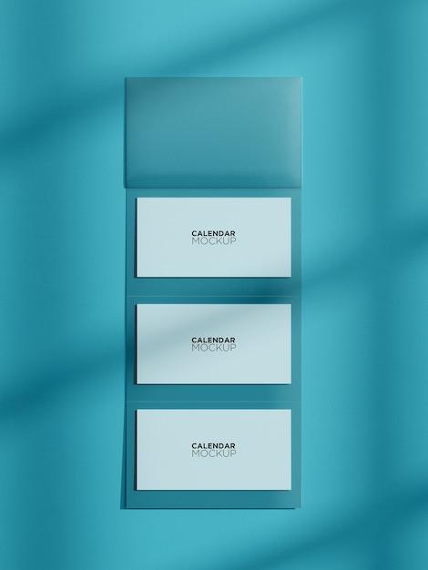 Maquete de calendário vertical isolada pendurada na parede Psd Premium