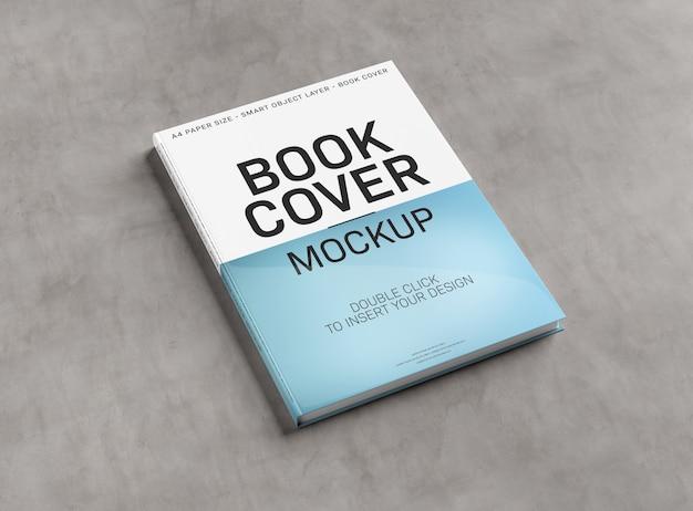 Maquete de capa de livro em branco no concreto Psd Premium