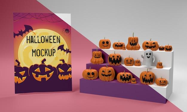 Maquete de cartão de halloween ao lado de abóboras assustadoras Psd grátis