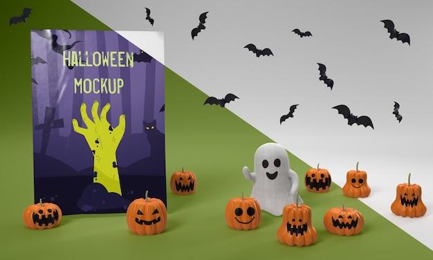 Maquete de cartão de halloween com abóboras assustadoras e fantasmas Psd grátis