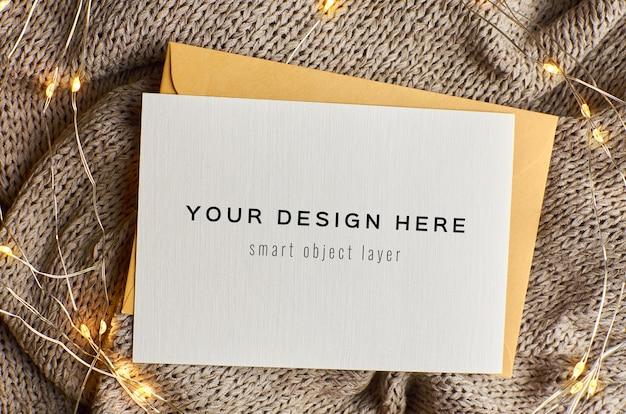 Maquete de cartão de natal com luzes de guirlanda Psd Premium