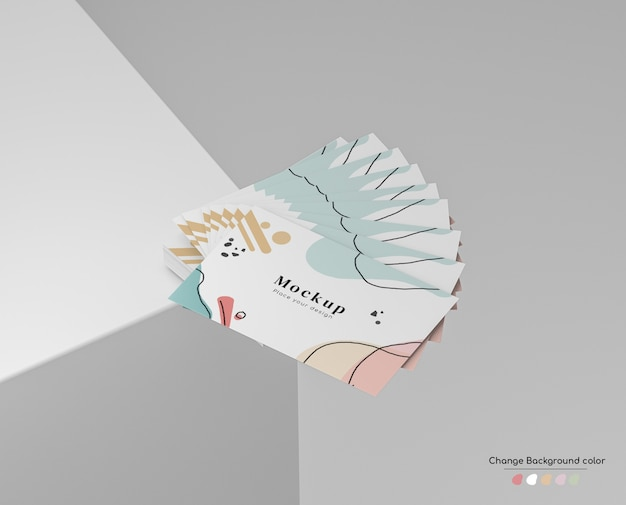 Maquete de cartão de visita de negócios mínima na disposição do ventilador de mão em um canto da plataforma. Psd grátis