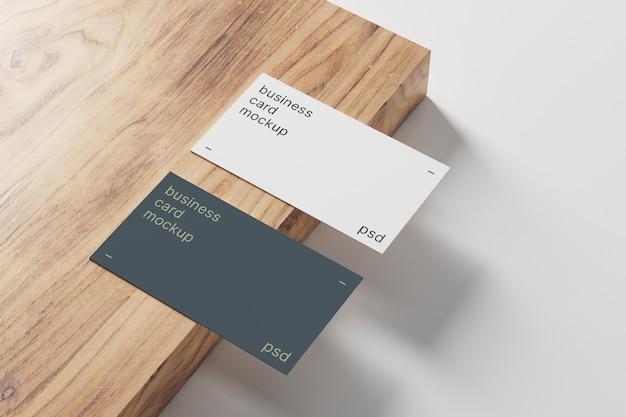 Maquete de cartões de visita em painel de madeira Psd Premium