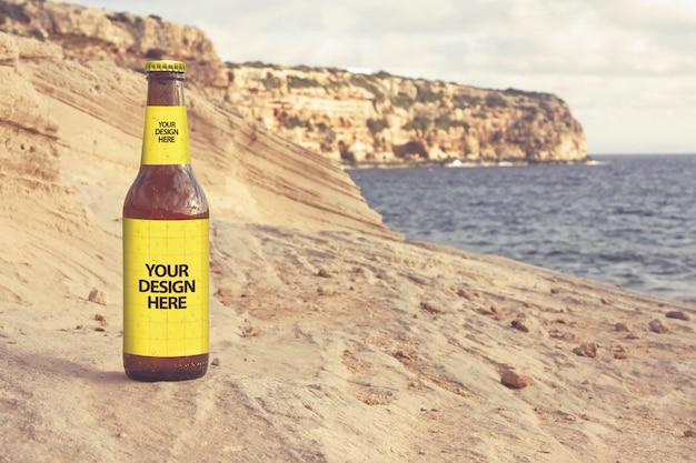 Maquete de cerveja de praia de arenito Psd Premium