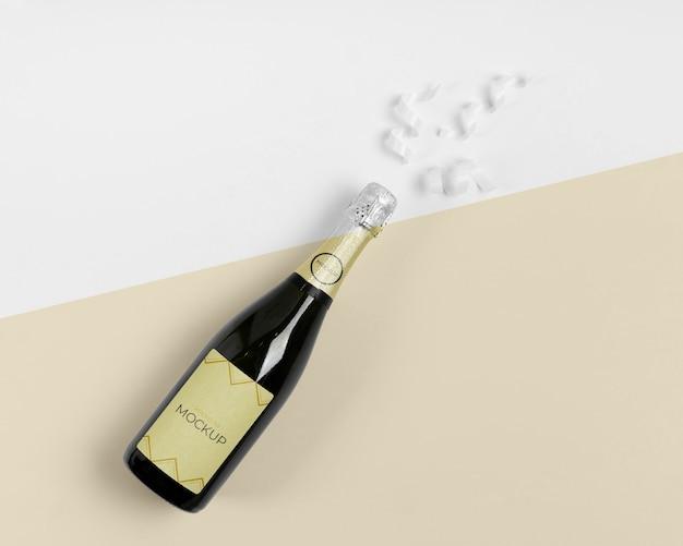 Maquete de champanhe com fitas brancas de vista superior Psd Premium