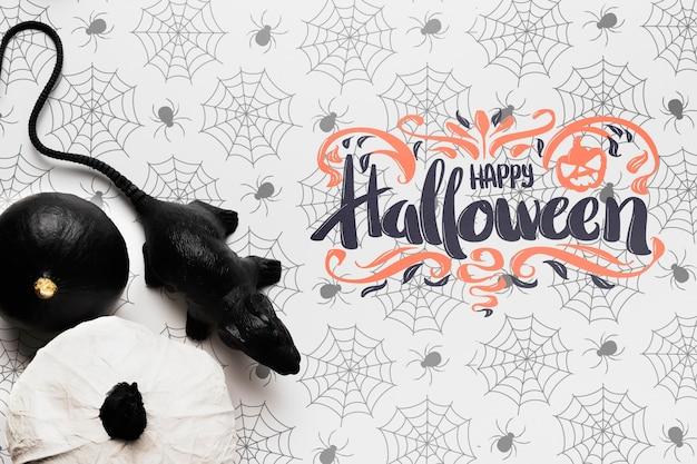 Maquete de conceito de halloween com abóboras e ratos Psd grátis