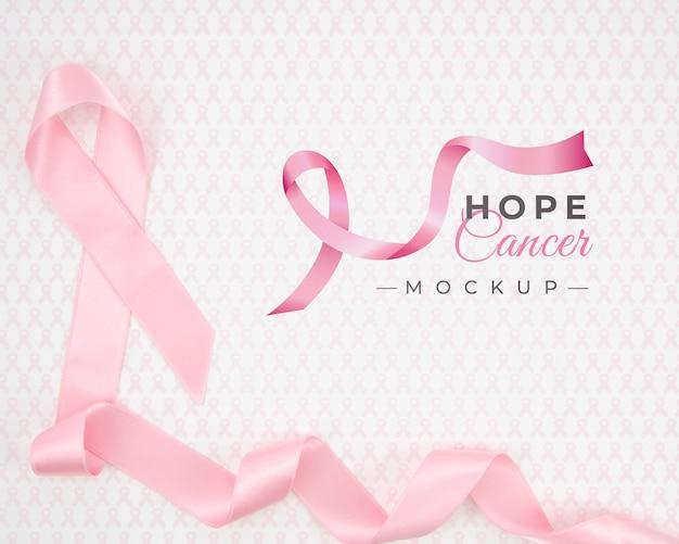 Maquete de conscientização do câncer de mama com fita rosa Psd Premium