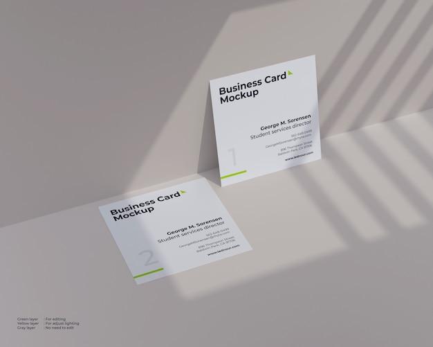 Maquete de dois cartões quadrados sob sombra Psd Premium