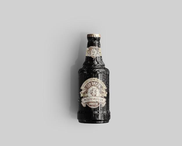 Maquete de garrafa de cerveja de vidro âmbar com gotas de água - vista superior Psd Premium