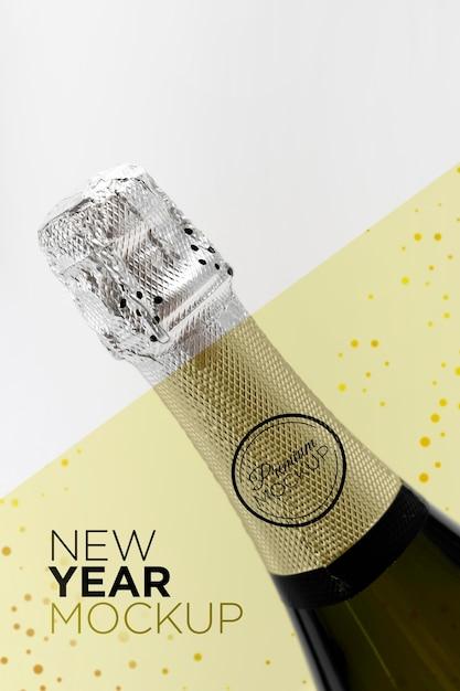 Maquete de garrafa de champanhe em close-up de ano novo Psd Premium