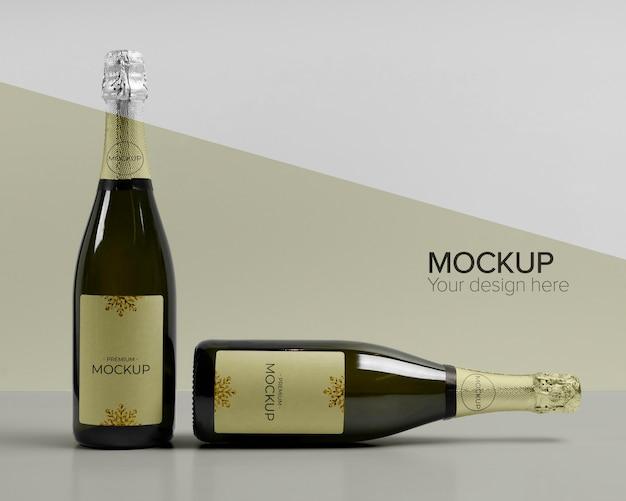 Maquete de garrafas de champanhe com vista frontal Psd Premium