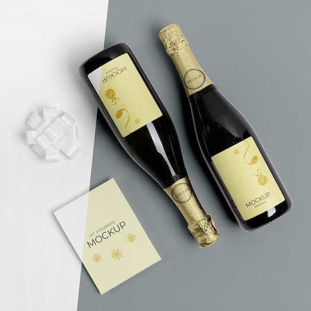Maquete de garrafas de champanhe plano Psd grátis