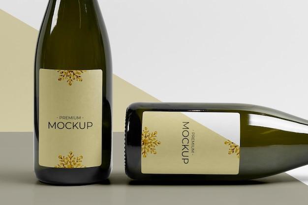 Maquete de garrafas de champanhe verticais e horizontais Psd Premium