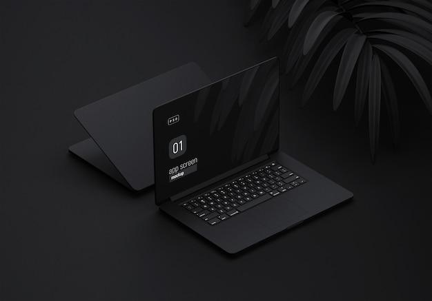 Maquete de laptop preto com folhas pretas Psd Premium