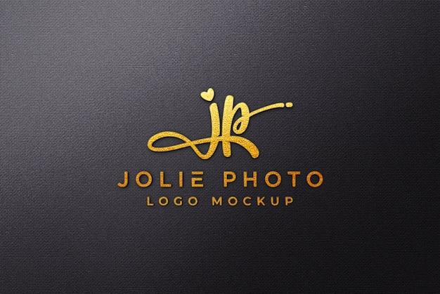 Maquete de logotipo 3d dourado em lona preta Psd Premium