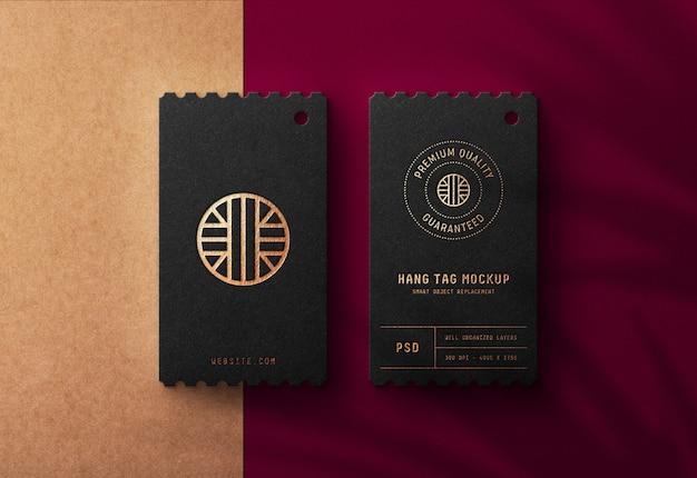 Maquete de logotipo de luxo em preto cair tag Psd Premium